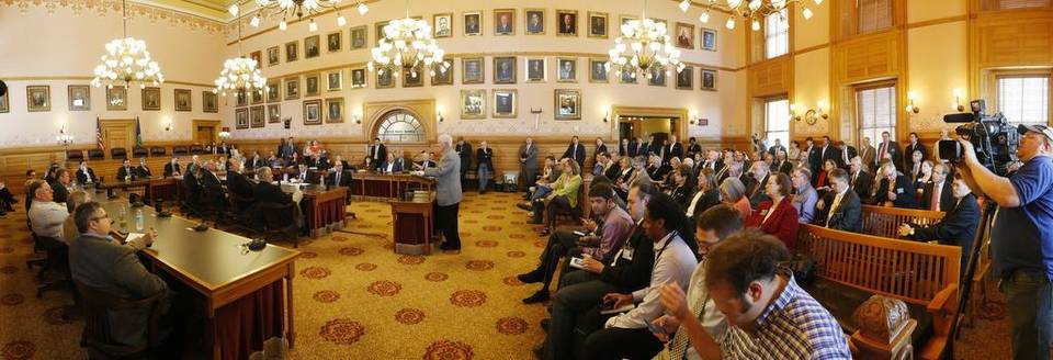Panoramic view inside the legislative chamber at the state capitol.